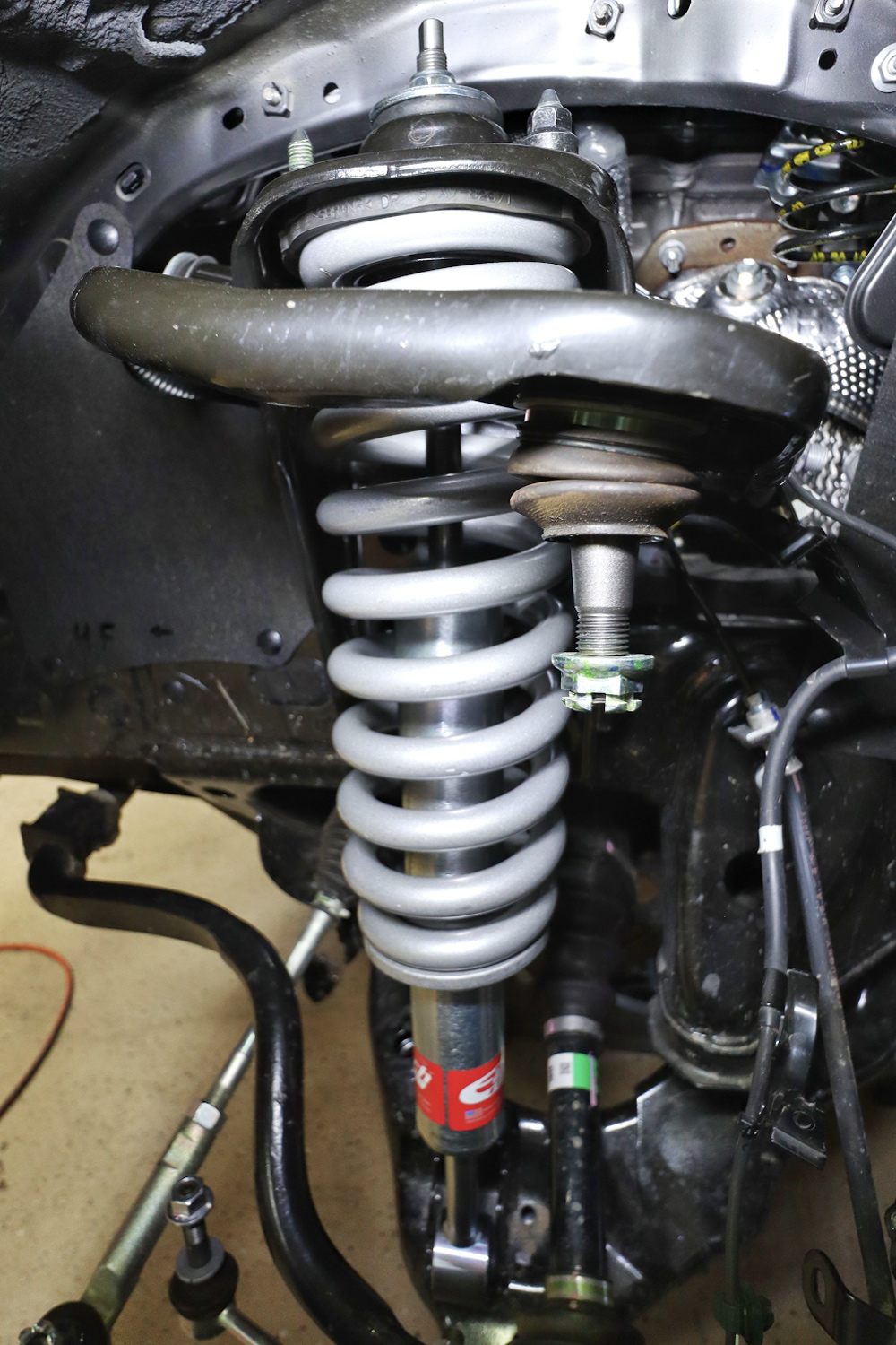 Eibach Pro-Truck Stage 1 Lift System - DIY Install + Overview For the 2020 3rd Gen Tacoma: STEP 13. INSTALL THE NEW EIBACH COILOVER
