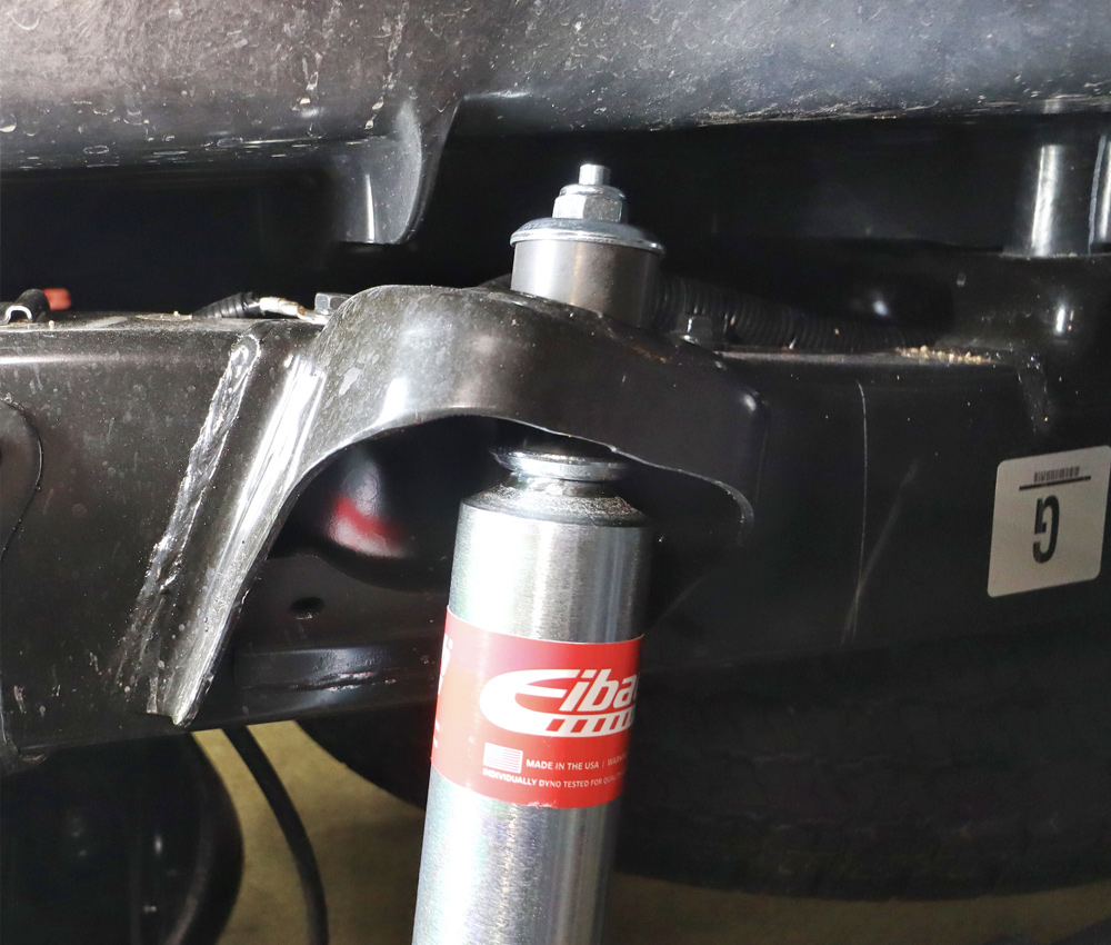 Eibach Pro-Truck Stage 1 Lift System - DIY Install + Overview For the 2020 3rd Gen Tacoma: STEP 29. INSERT EIBACH REAR SHOCK