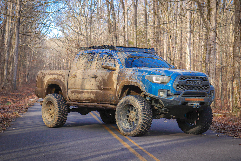 Lifted Blazing Blue Pearl Tacoma with King Off-Road Coilover Shocks