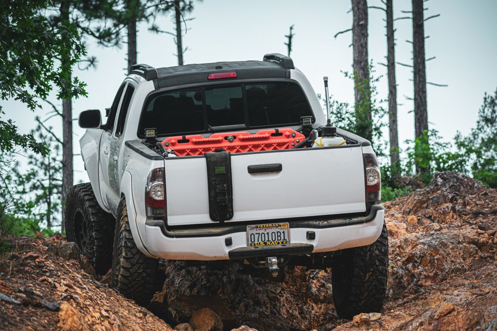 Lifted Super White 2nd Gen Tacoma with Recovery Boards