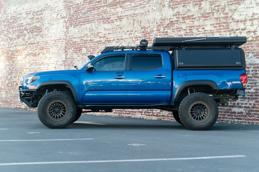 Blazing Blue Pearl 3rd Gen Tacoma with Relations Race Wheels and RSG Offroad Rock Sliders