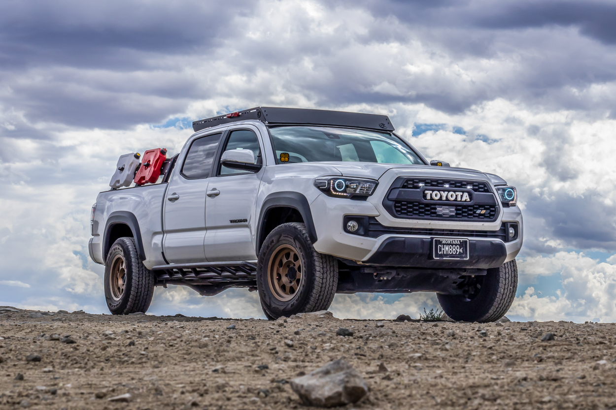Super White 3rd Gen Tacoma with AL Offroad Roof Rack, Rago Fabrication Rock Sliders & Method Wheels