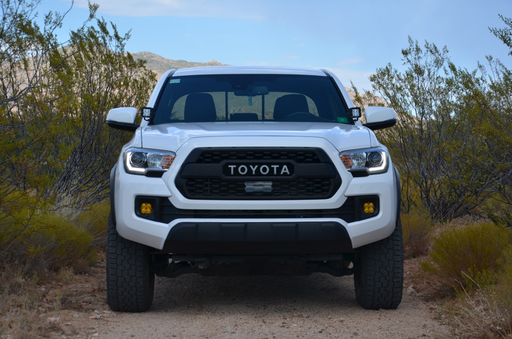 Super White 3rd Gen Tacoma with TRD Pro Grille and Baja Designs Squadron Sports
