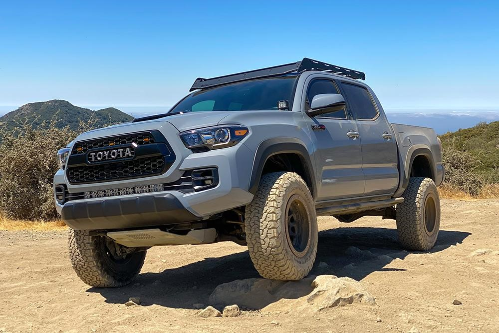 Lifted Cement TRD Pro 3rd Gen Tacoma with Wescott Designs Lift Kit and Stealth Custom Series Wheels