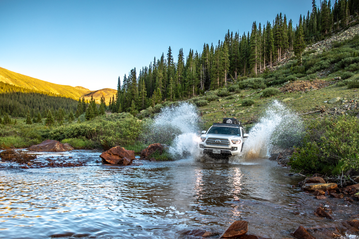3rd Gen Tacoma Water Crossing at Sunset on Red Cone Pass