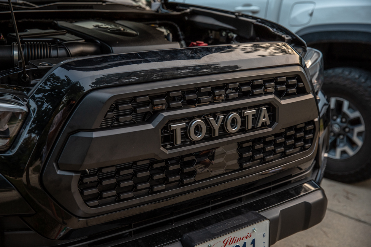 Midnight Black Metallic 3rd Gen Tacoma with TRD Pro Grille & LED Raptor Lights