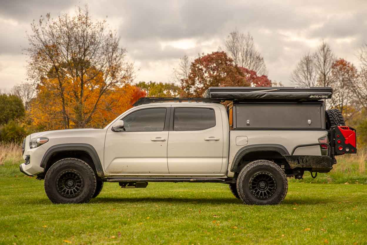 Lifted 3rd Gen Tacoma with AluCab Explorer Canopy, RRW RR6H & DOM Bolt-On Rock Sliders