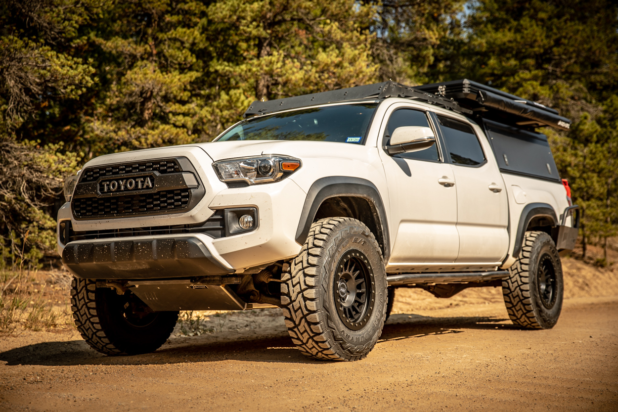 Lifted Super White 3rd Gen Tacoma on 34s with Relations Race Wheels Bolt-On Rock Sliders