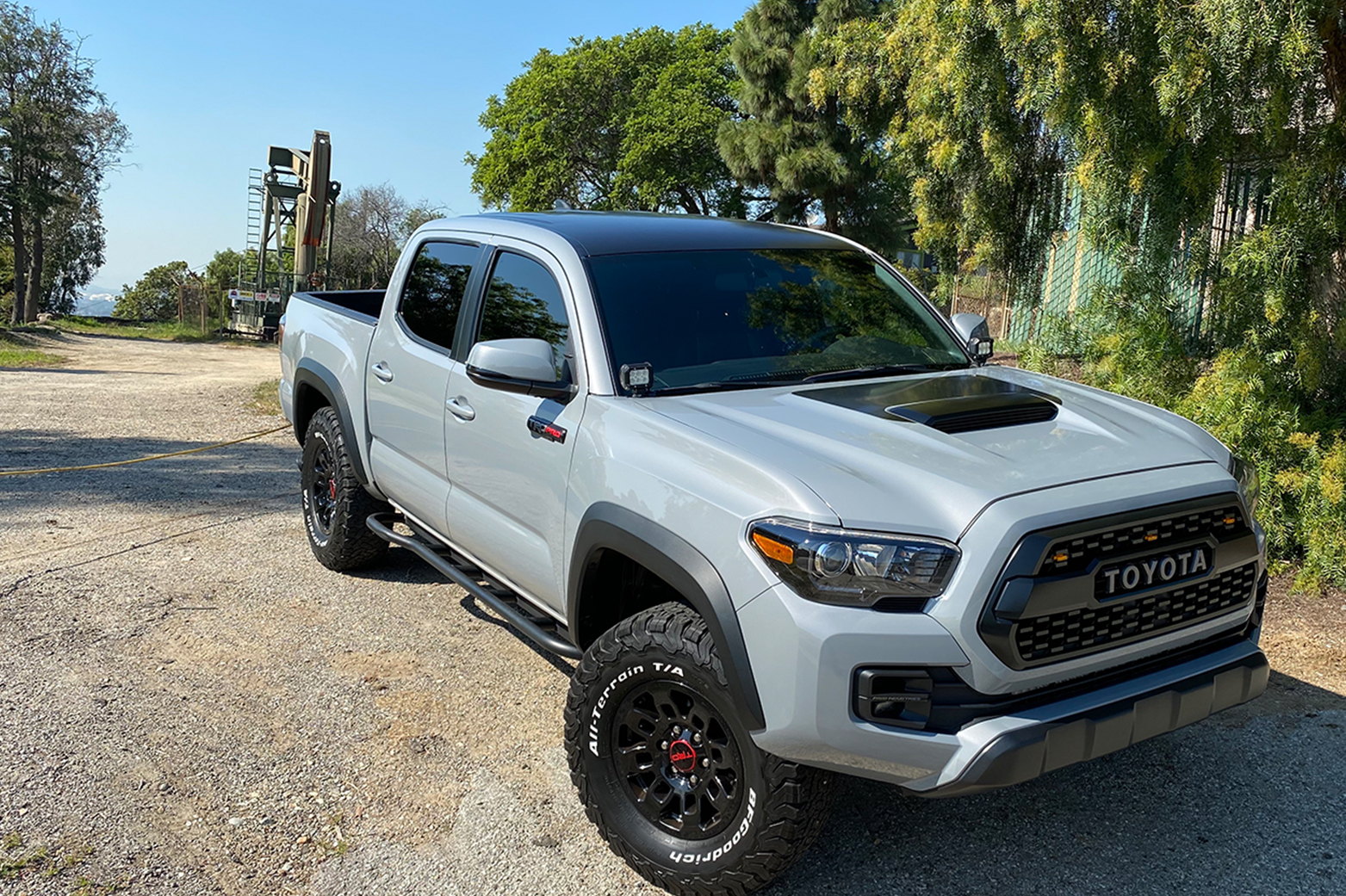 Lifted Cement TRD Pro 3rd Gen Tacoma with Satin Black Vinyl Wrapped Roof