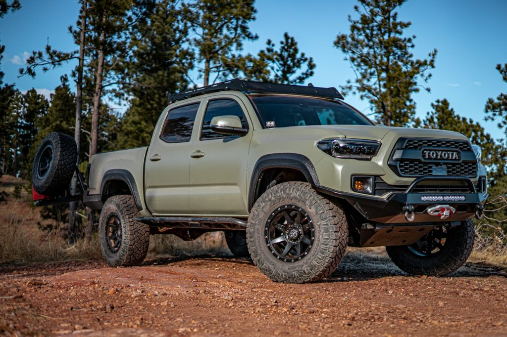 Lifted 3rd Gen Toyota Tacoma with C4 Fabrication Bolt-On Rock Sliders