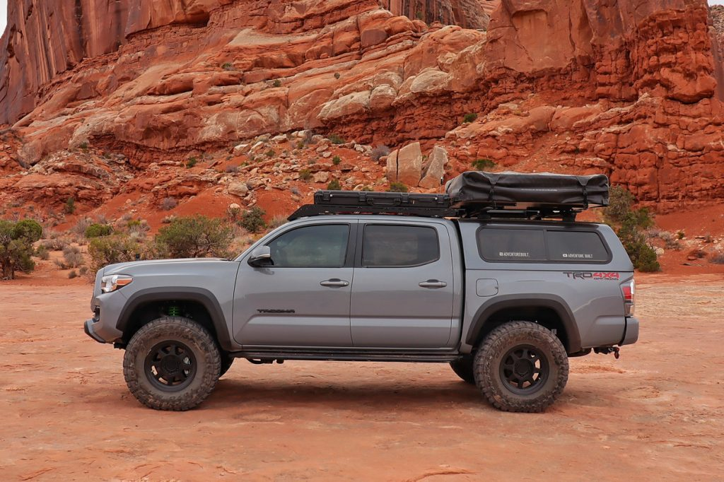 Lifted Cement 3rd Gen Tacoma with Toyota Pro Shop Black Emblem Overlay Kit