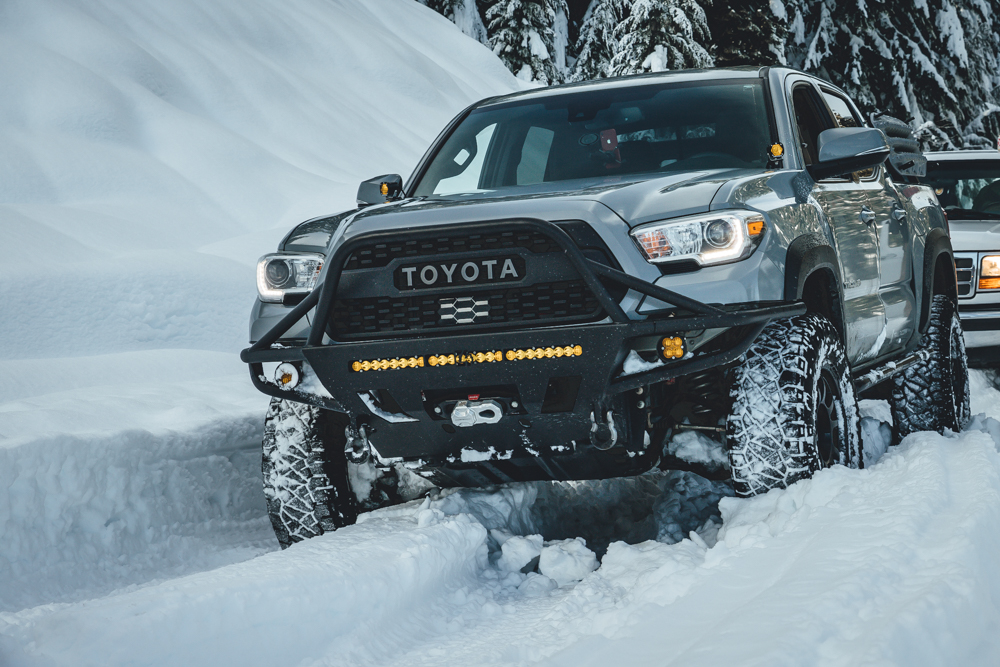 Lifted Cement 3rd Gen Tacoma with C4 Hybrid Front Bumper with Agency 6 Winch Shackle