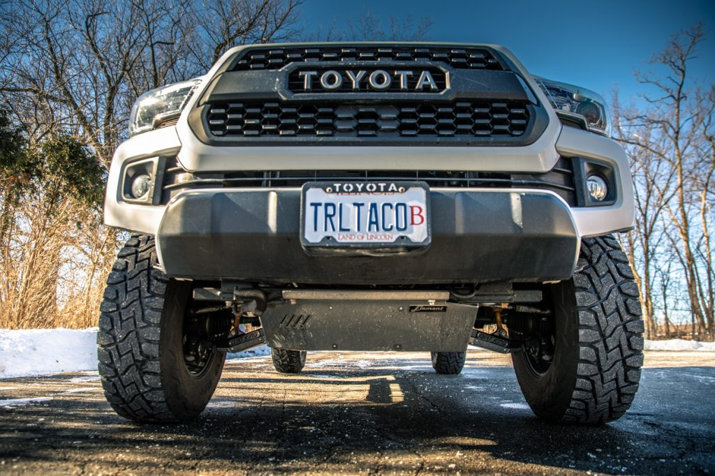 Lifted Super White 3rd Gen Toyota Tacoma with Dirt King Fabrication Performance Lower Control Arms