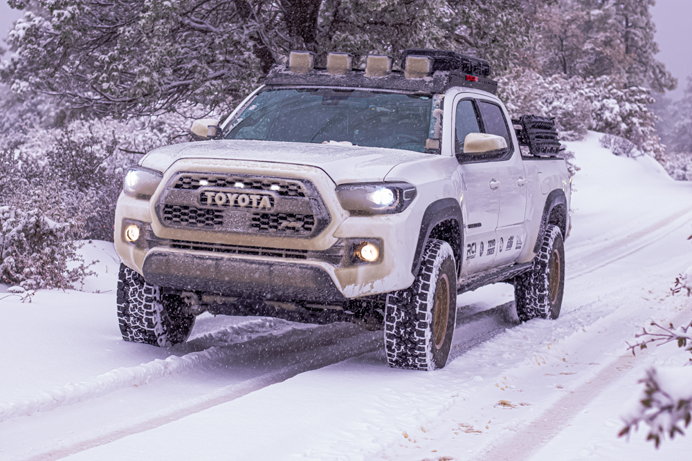 Super White 3rd Gen Tacoma with AL Offroad Aluminum Roof Rack & Toyo Open Country AT3s in the Snow