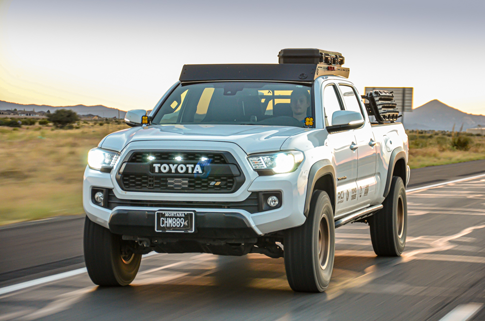 Lifted Super White 3rd Gen Tacoma with Ironman Stage 2 Foam Cell Pro Lift Kit and Custom Blacked Out Retrofit Headlights