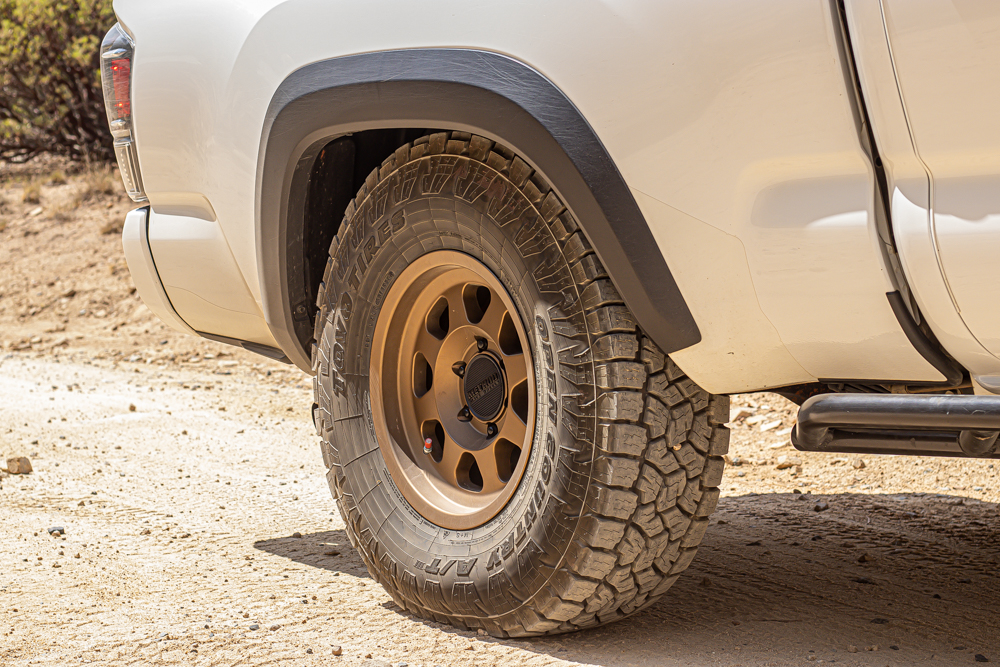 Method Race Wheels Bronze 701 with Toyo Tires Open Country AT3s on Super White 3rd Gen Toyota Tacoma