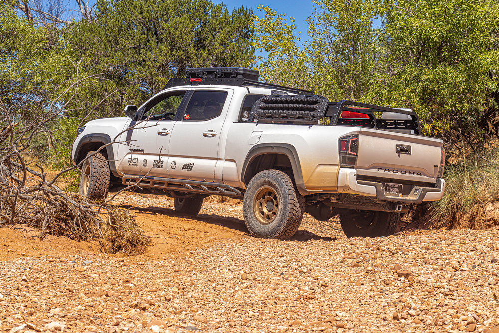 Lifted Super White 3rd Gen Tacoma with RCI Bed Rack, Method Race Wheels 701 and Black Maxtrax