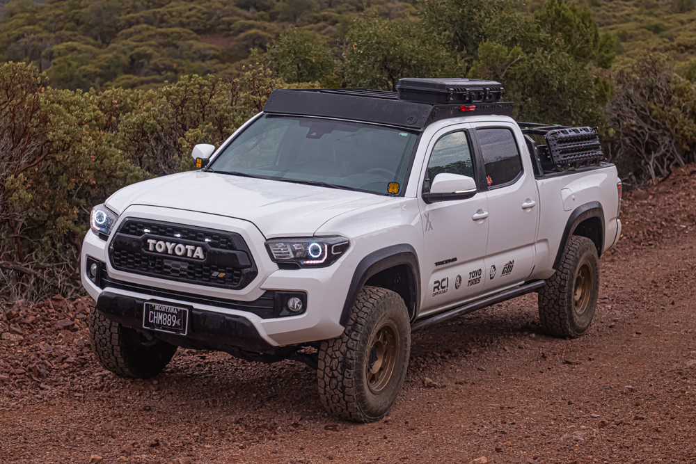 """Lifted Double Cab Long Bed Super White 3rd Gen Tacoma with 33"""" Tires & Bed Rack with Maxtrax"""
