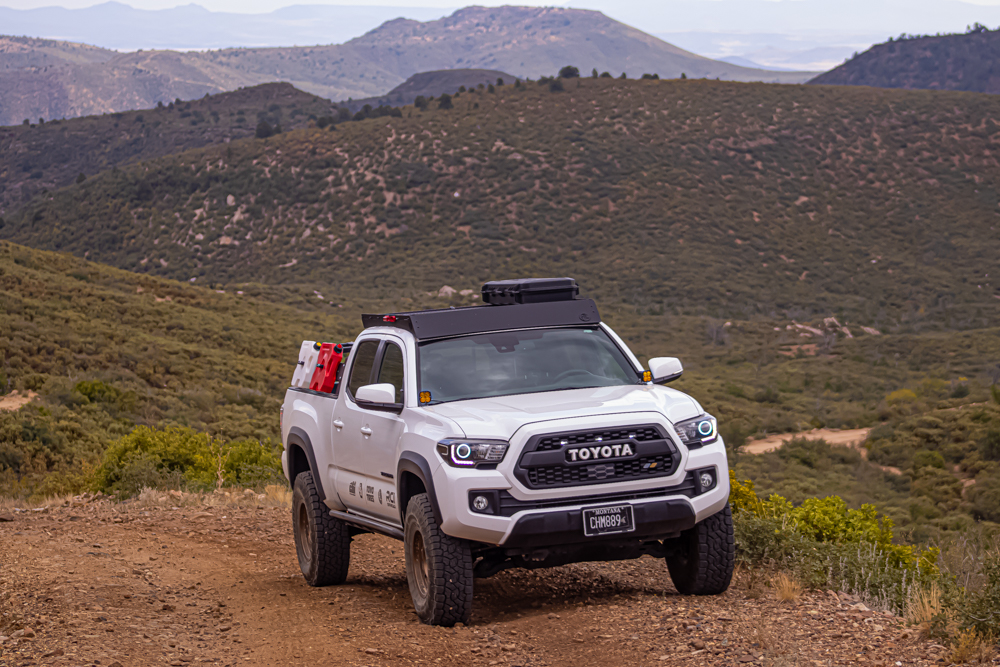 Lifted Super White Tacoma with AL Off-Road Aluminum Roof Rack and Toyo Open Country AT 3s