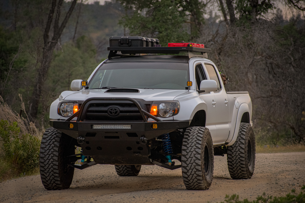 Lifted Long Travel 2nd Gen Tacoma with Fiberglass Fenders & FrontRunner Roof Rack