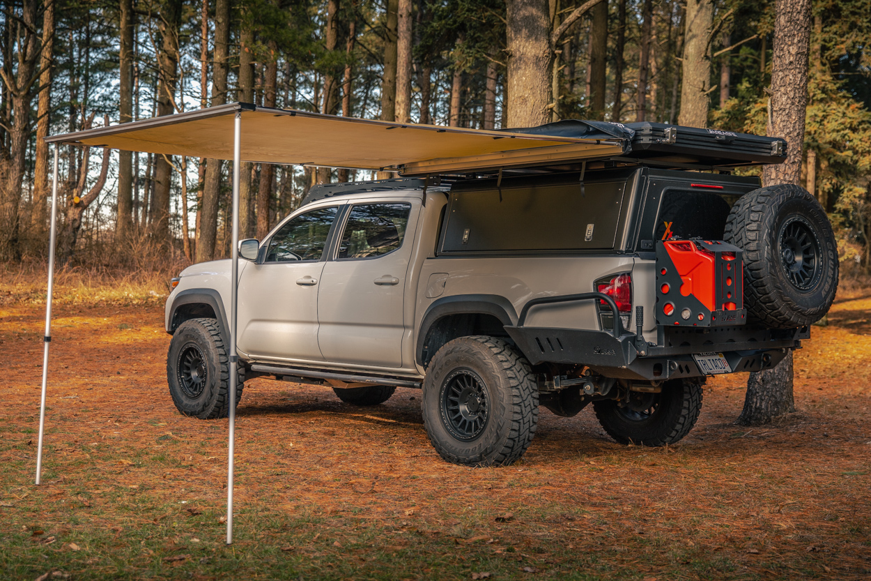 Lifted Super White 3rd Gen Tacoma with AreaBFE Awning on AreBFE Rooftop Tent