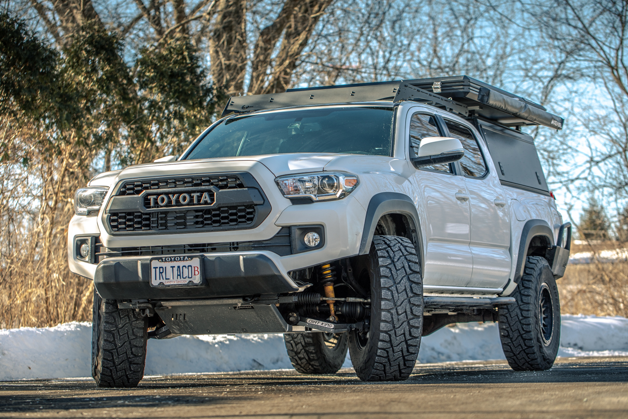 Lifted Super White 3rd Gen Tacoma with Dirt King Fabrication Aftermarket Upper and Lower Control Arms & Toyo Open Country R/T