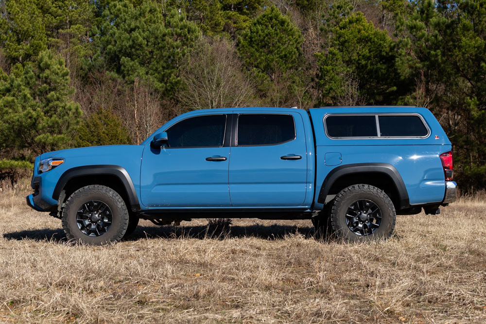 Cavalry Blue 3rd Gen Tacoma with Leer 100R Camper Shell