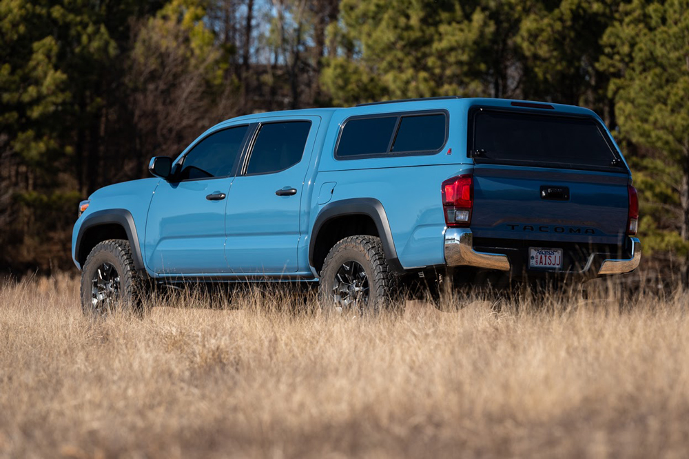 Cavalry Blue Double Cab Short Bed 3rd Gen Toyota Tacoma with Leer 100R Camper Shell