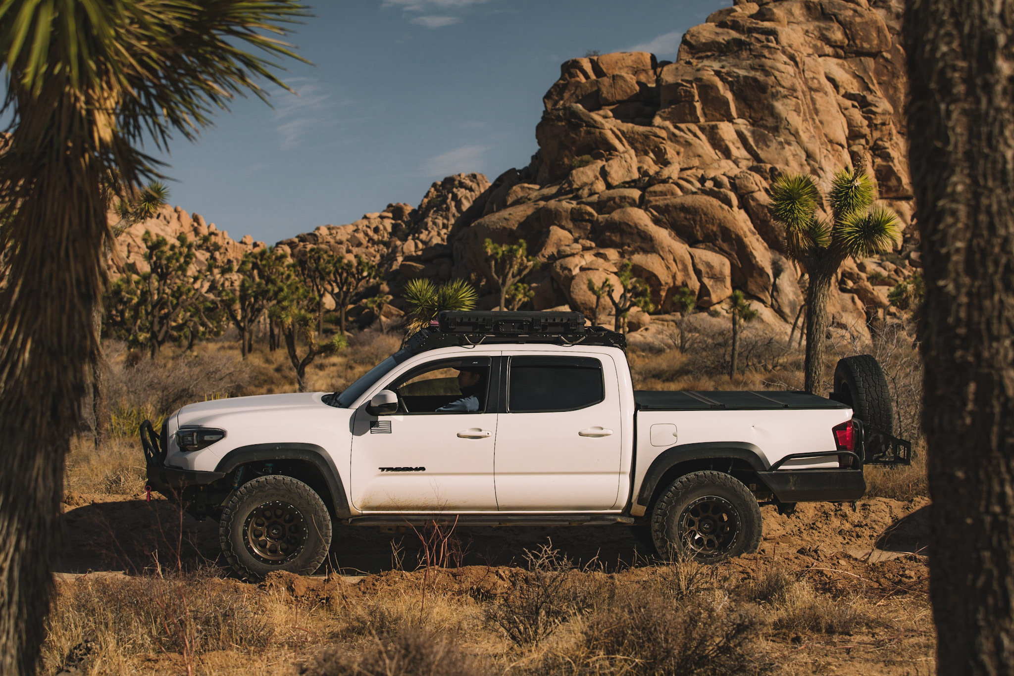 Lifted Super White 3rd Gen Tacoma with Brute Force Fabrication Front & Rear Bumpers