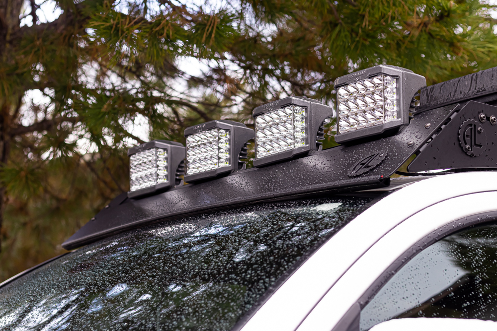 Ironman 4x4 Universal Eclipse Driving Lights on AL Offroad Roof Rack for Toyota Tacoma