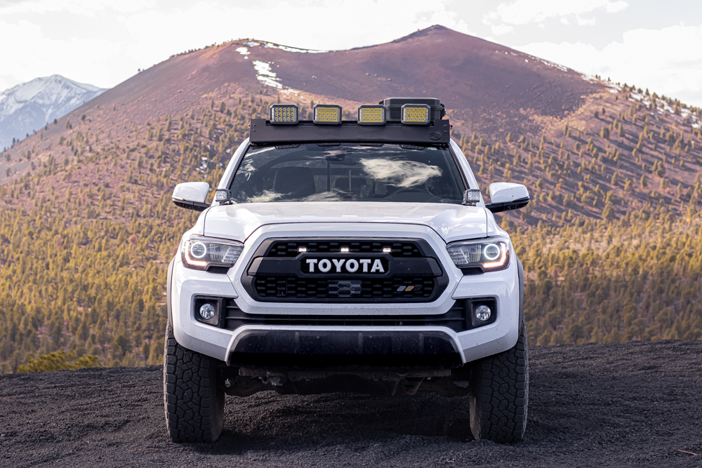 Lifted Super White 3rd Gen Tacoma with TRD Pro Grille, Ironman 4X4 LED Lights on AL Offroad Aluminum Roof Rack