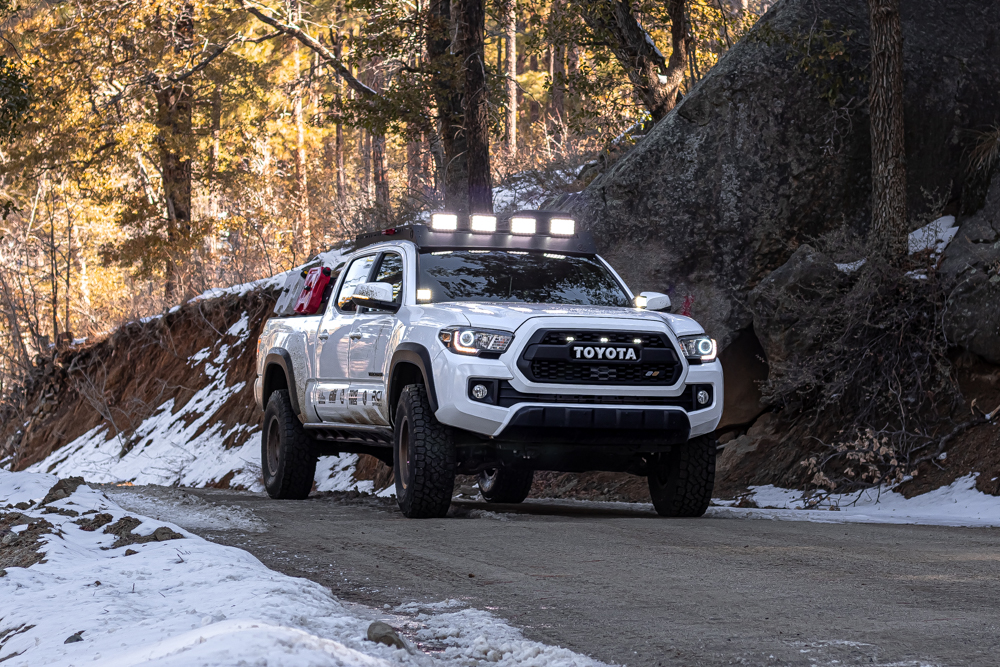 Lifted Super White 3rd Gen Tacoma with AL Offroad Roof Rack & Ironman 4X4 LED Lights