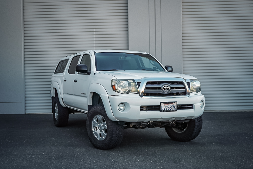 Super White 2nd Gen Tacoma with Old Man Emu (OME) Lift Kit