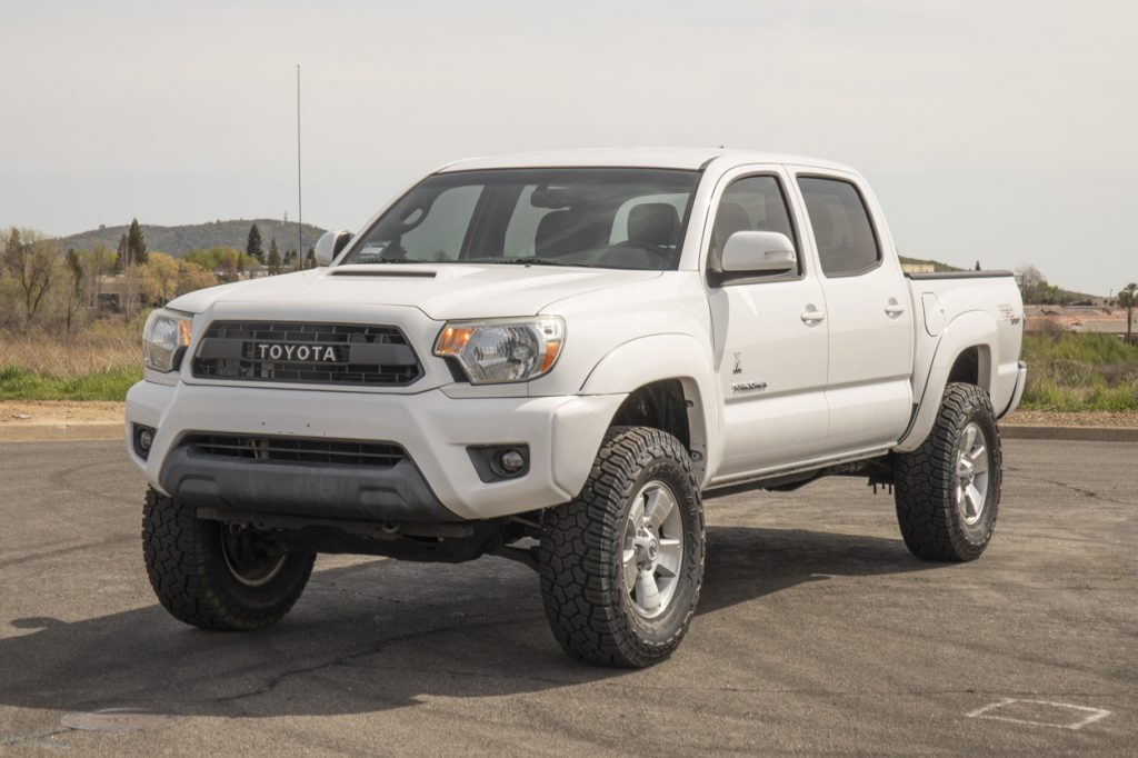 "Lifted Super White 2nd Gen Tacoma with 33"" Tires & G2 Wheel Spacers"