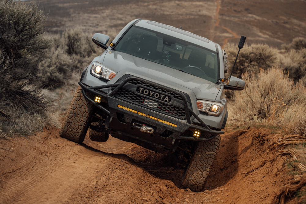 Lifted Cement 3rd Gen Toyota Tacoma with weBoost Drive Reach OTR & C4 Fabrication Front Bumper