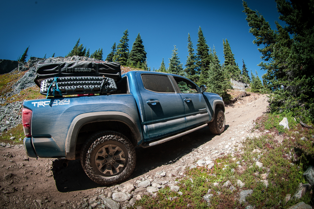 Lifted Calvary Blue 3rd Gen Tacoma with Bed Rack & Rooftop Tent on Whipsaw Creek Trail