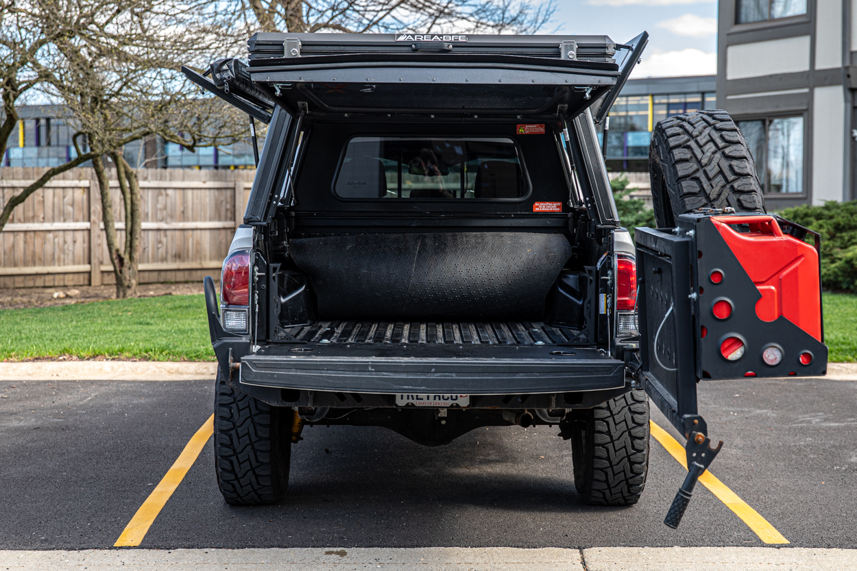Lifted 3rd Gen Tacoma with C4 High Clearance Swing Away Rear Bumper & AreaBFE Rooftop Tent