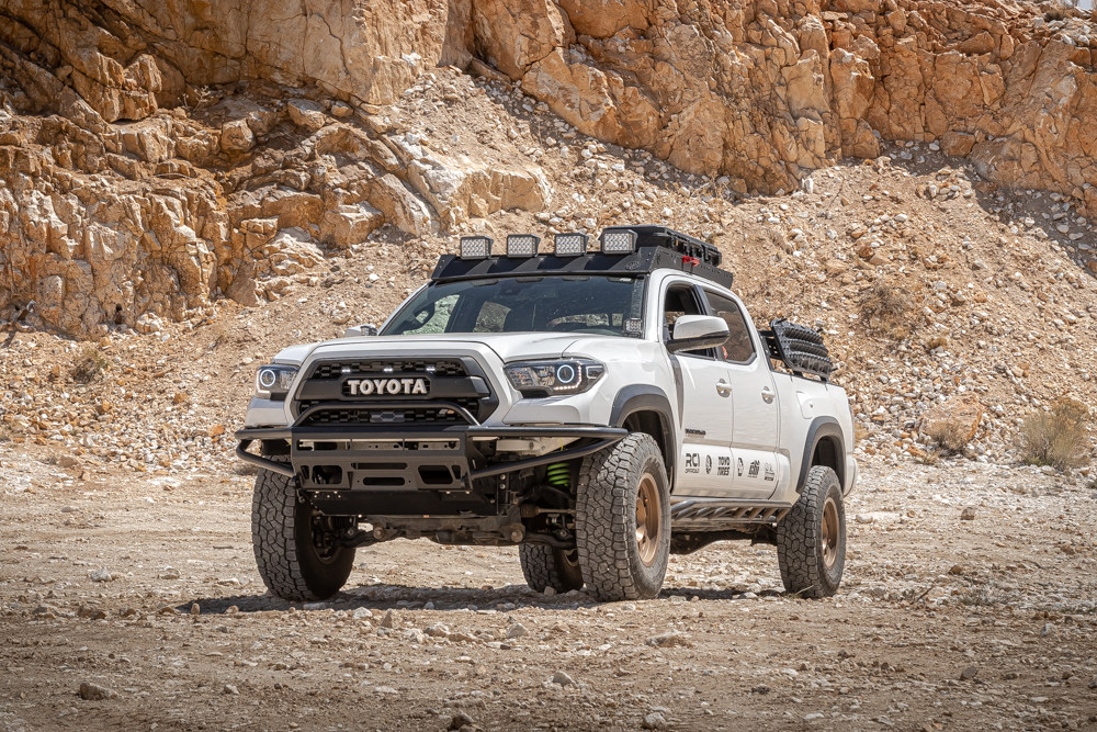 Lifted Super White 3rd Gen Tacoma with Method Race Wheels, AL Offroad Aluminum Roof Rack & BAMF Hybrid Front Bumper