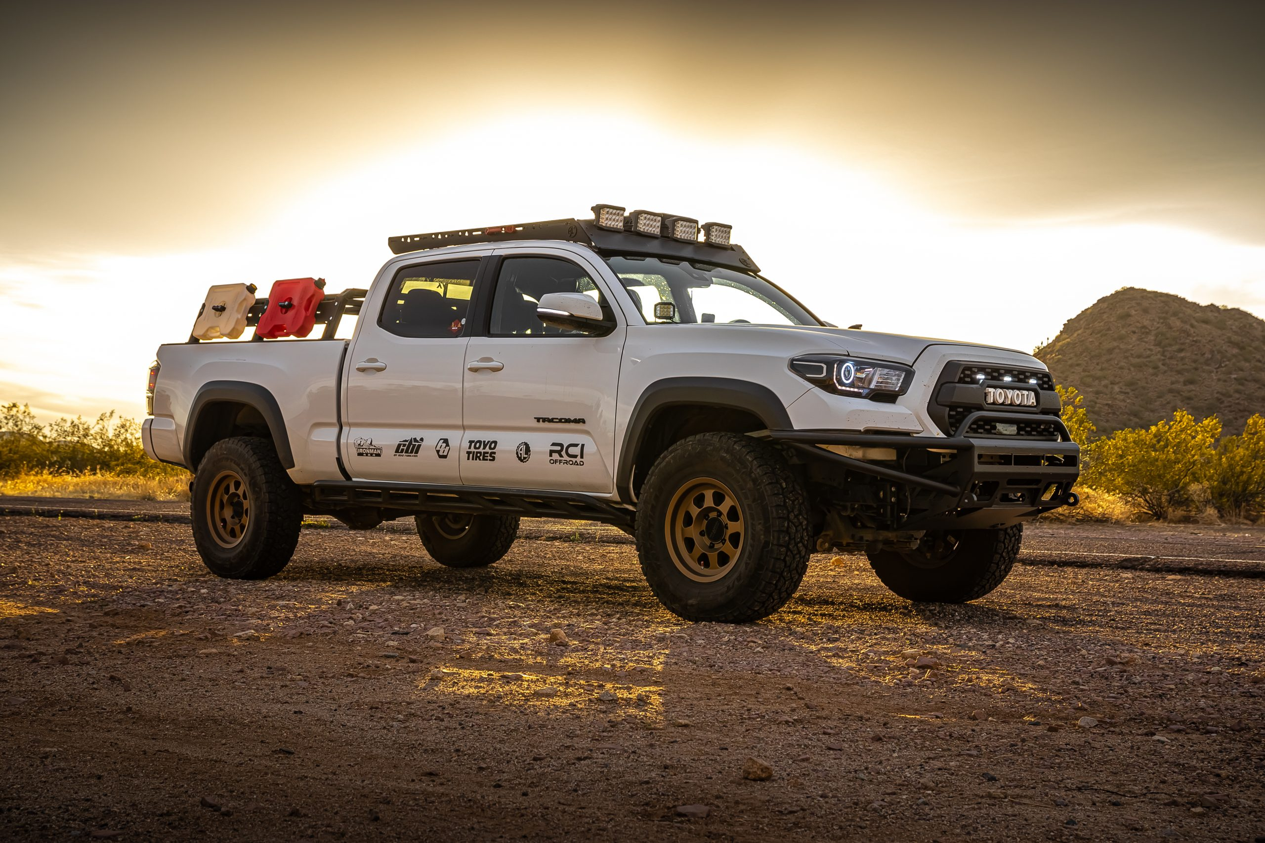 Lifted Super White 3rd Gen Tacoma on 33s with BAMF Hybrid Front Bumper and Ironman LED Lights
