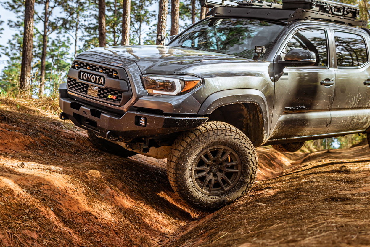 Lifted Magnetic Gray Metallic 3rd Gen Tacoma with Backwoods Adventure Mods High Clearance Front Bumper & Falken Wildpeak AT3s