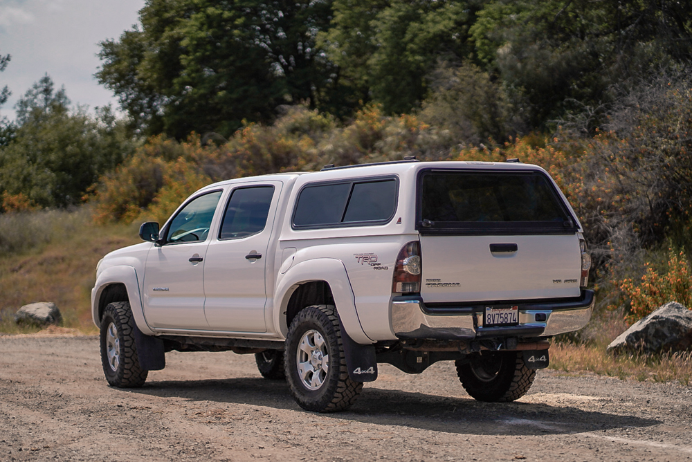 Lifted Super White 2nd Gen Tacoma with Leer Truck Cap & Goodyear Duratracs