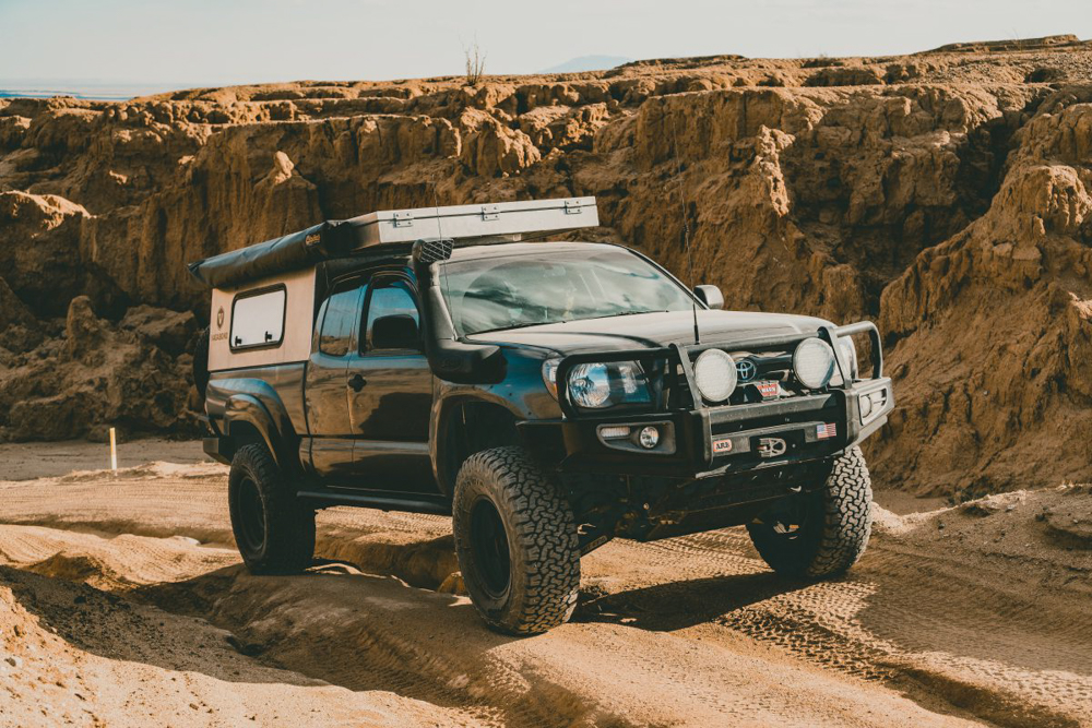 Lifted 2nd Gen Access Cab Tacoma with Vagabond Outdoors The Drifter Camper