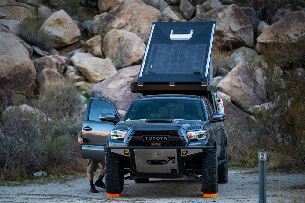 Lifted MGM 3rd Gen Tacoma with Wedge Style Pop Up Camper
