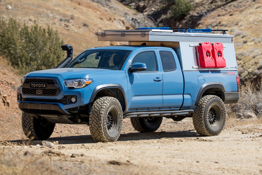 Lifted Cavalry Blue 3rd Gen Tacoma with Snorkel & Vagabond Outdoors Camper