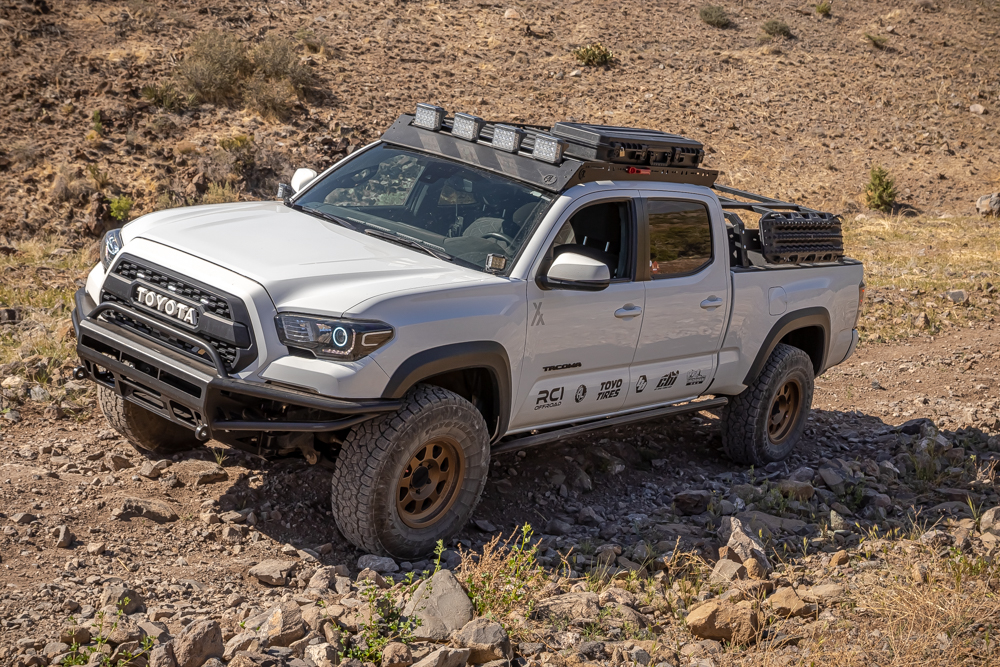 Lifted Super White 3rd Gen Tacoma with BAMF Hybrid Front Bumper & AL Offroad Roof Rack
