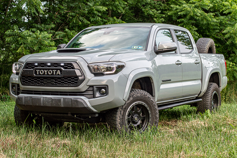 Lifted Cement 3rd Gen Tacoma with LED Raptor Lights, Fuel Wheels & Truck Bed Spare Tire Mount