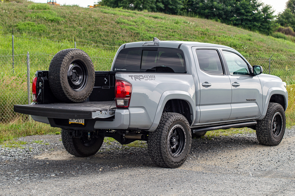 Cement 3rd Gen Tacoma with Fuel Wheels & Mobtown Rock Sliders