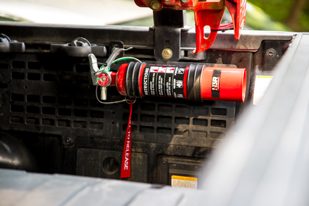H3R Performance MaxOut Fire Extinguisher Mounted on Tacoma Truck Bed Molle Panel