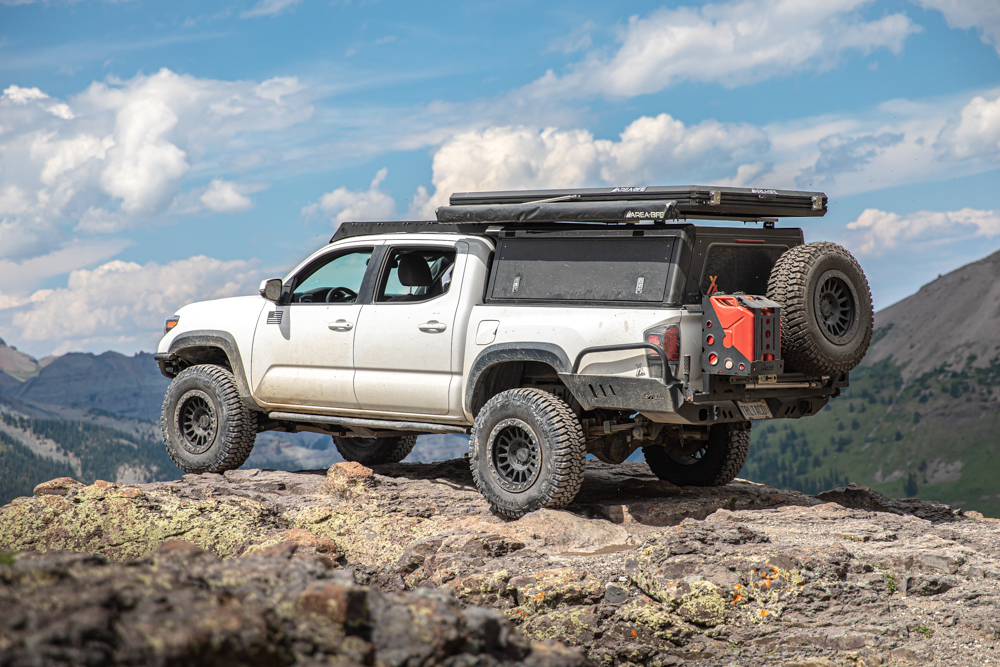 Lifted 3rd Gen Tacoma with AluCab Explorer Canopy & AreaBFE Rooftop Tent