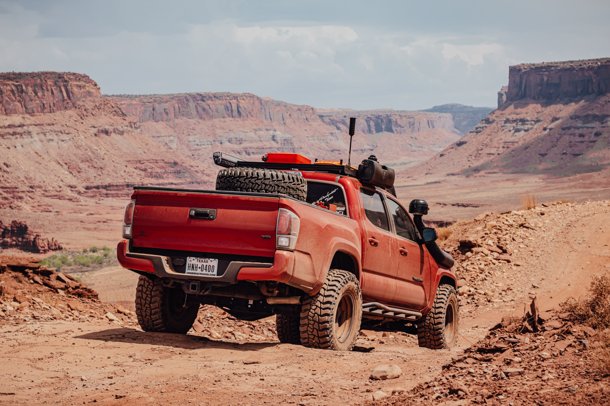Lifted Barcelona Red Metallic 3rd Gen Toyota Tacoma Off-Road Trail in Moab, Utah